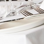 Plain white table linen with confectionery