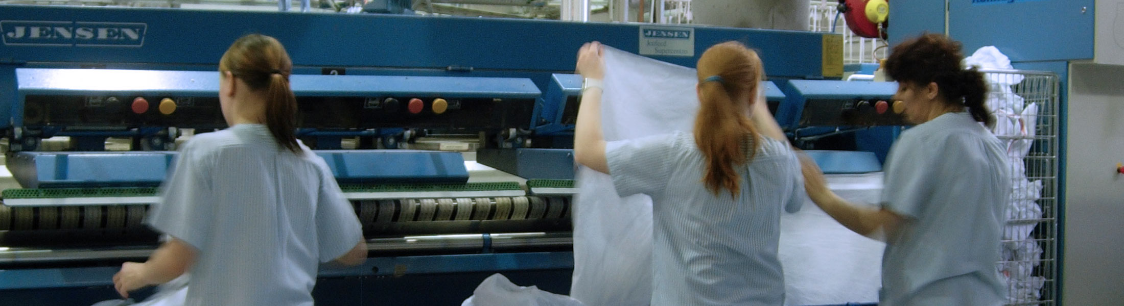 Laundry workers sorting linen