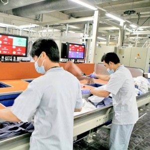 Laundry workers wearing protective clothing