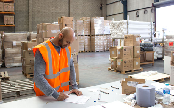 Staff member working in new warehouse